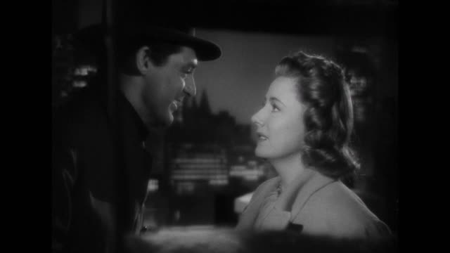 1941 Woman (Irene Dunne) feigns excitement when man (Cary Grant) tells her about his job offer in Japan