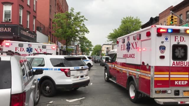 A woman fell from the roof of a building in Park Slope She hit the tin roof of the grocery before landing on the pavement