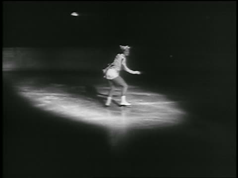 b/w 1935 woman figure skating in spotlight on ice rink / richmond canada - 1935 stock videos & royalty-free footage