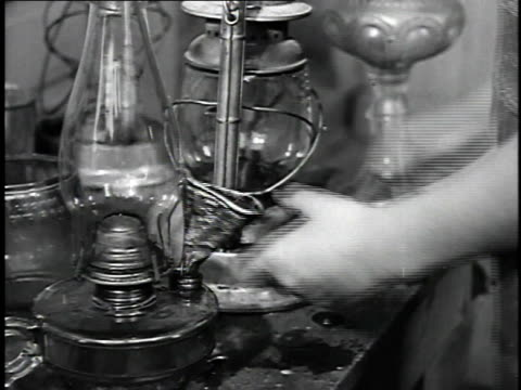 1923 cu woman filling oil lamps / united states - laboratory equipment stock videos & royalty-free footage