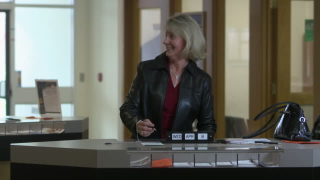 ms woman filling out deposit form, bethlehem, pennsylvania, usa - bethlehem pennsylvania stock videos and b-roll footage