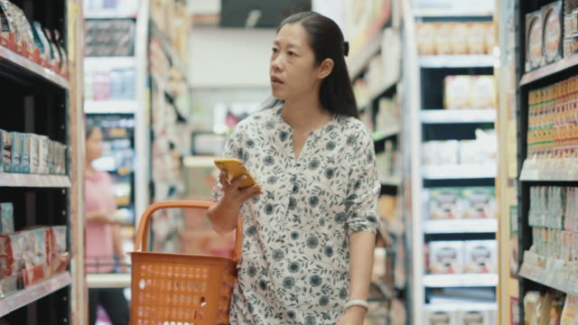 Woman finding product inside supermarket