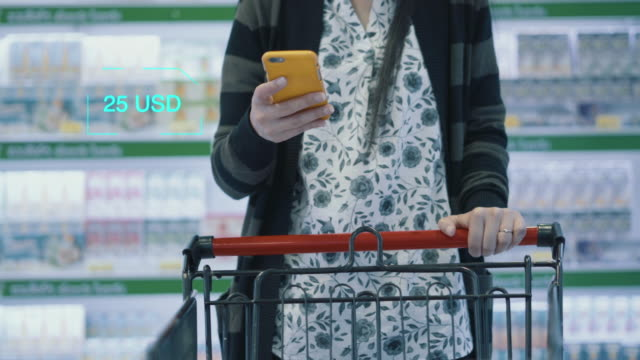 woman finding product inside supermarket - donne anziane video stock e b–roll