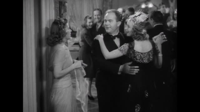 1941 woman (irene dunne) finds herself alone at a crowded party on new year's eve - loneliness stock videos & royalty-free footage