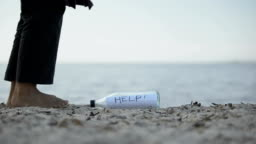 Woman finds message Help in bottle, chance to save survivors, find missed people