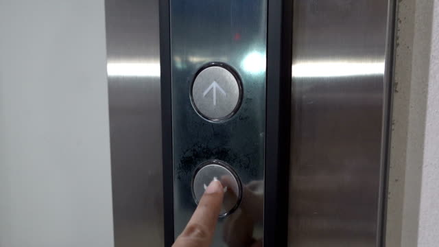 woman finger presses the button for an elevator down - pushing stock videos & royalty-free footage