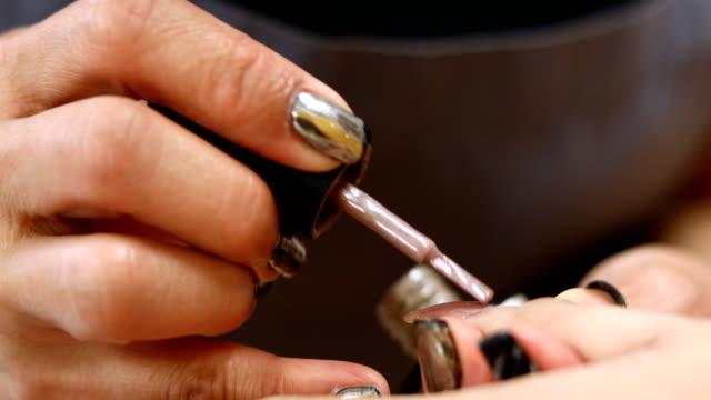 woman fingernail manicure in beauty salon