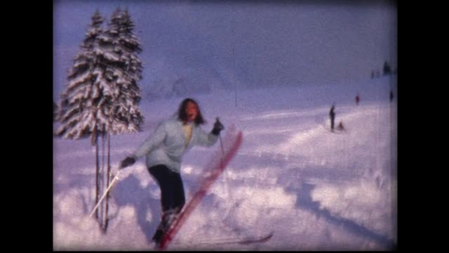 1967 woman first time on skis comic adventure - skifahren stock-videos und b-roll-filmmaterial