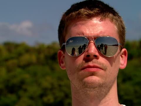 vídeos y material grabado en eventos de stock de cu,  woman fixing hair of man wearing reflective sunglasses - barba de tres días