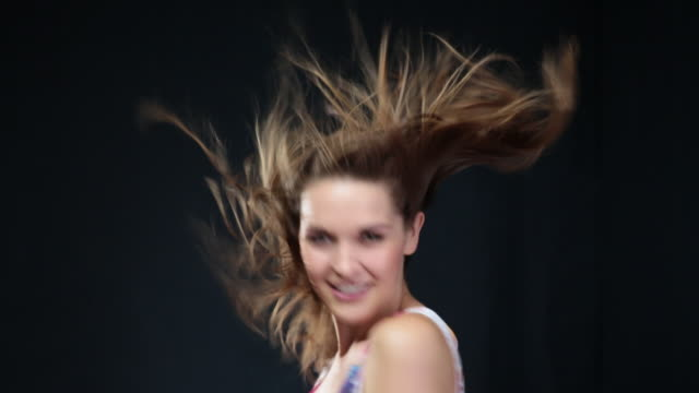 ms woman flicking hair around in wind while dancing around / london, greater london, united kingdom - greater london video stock e b–roll