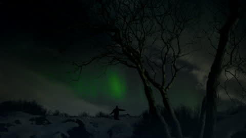 woman flings hands out joyously under northern lights - real time stock videos & royalty-free footage