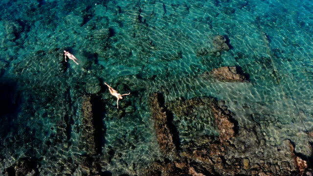 woman floating in sunken city. - old ruin stock videos & royalty-free footage