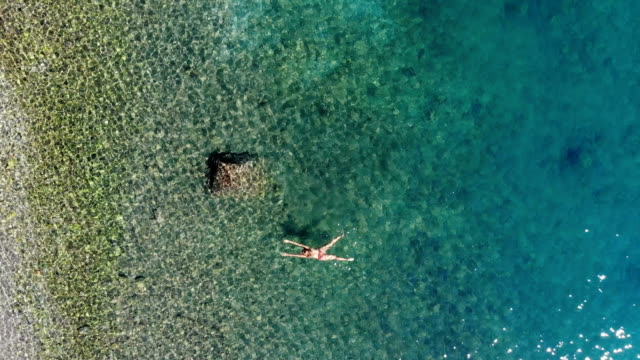 woman floating in the shallow sea. - marmaris stock videos & royalty-free footage