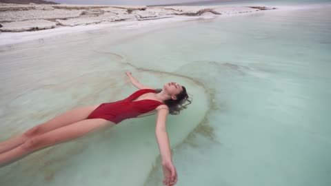 woman floating on water  in dead sea - floating on water stock videos & royalty-free footage