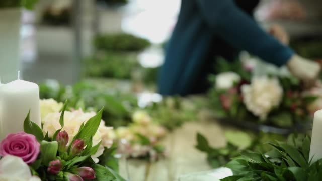 Woman florist working in flower workshop