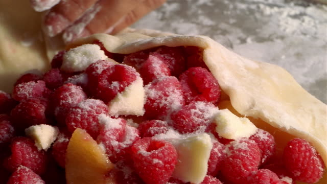 ECU PAN woman folding dough with raspberries