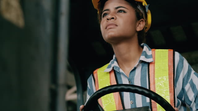 woman fork lift operation, looking around. woman in industry concept. slow motion. - hard hat stock videos & royalty-free footage