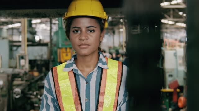 woman fork lift operation, portrait. woman in industry concept. slow motion. - manufacturing occupation stock videos & royalty-free footage