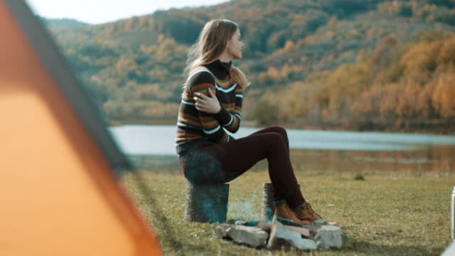 woman freezing on camping trip by the lake - shaking stock videos & royalty-free footage