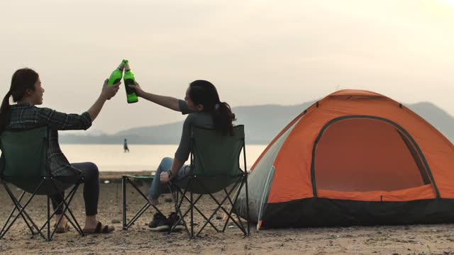 woman friend couple camping together on beach - indian couple tea stock videos & royalty-free footage