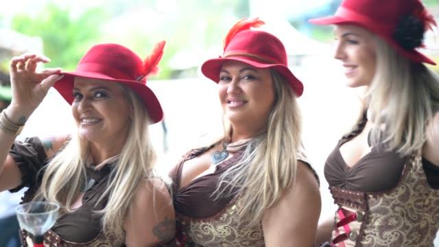 woman friends portrait at oktoberfest in blumenau, santa catarina, brazil - stage costume stock videos & royalty-free footage