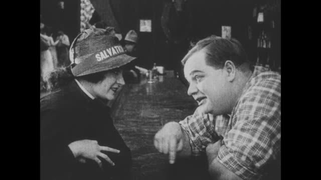 1918 A woman from the Salvation Army flirts with man (Fatty Arbuckle)