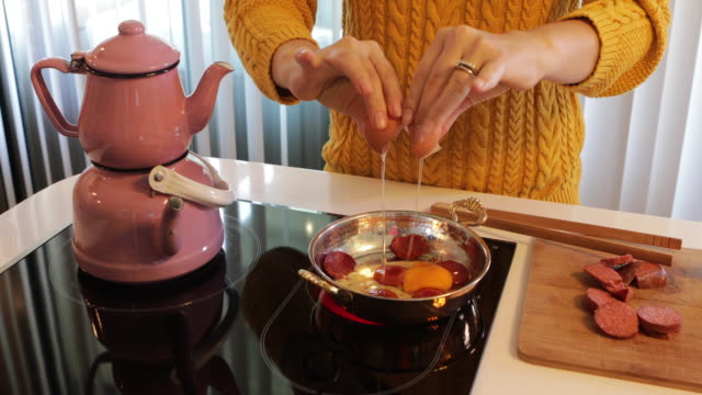 woman frying egg - cooking pan stock videos & royalty-free footage