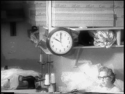 b/w 1958 woman garment worker talking in workshop under clock during strike / newsreel - 1958 stock videos & royalty-free footage