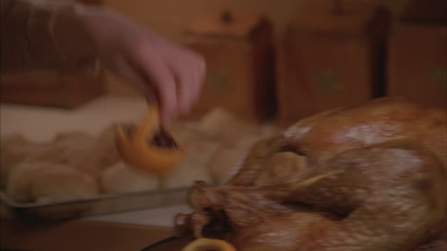 a woman garnishes the plate holding a thanksgiving turkey. - thanksgiving plate stock videos & royalty-free footage