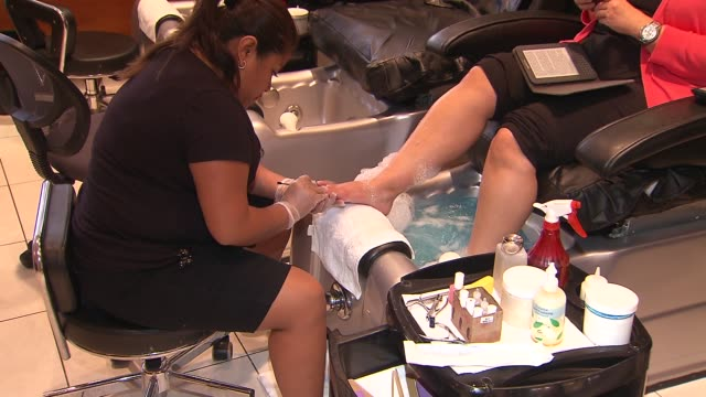 woman gets a pedicure at serenity spa on august 29 2013 in paramus new jersey - pedicure stock videos & royalty-free footage