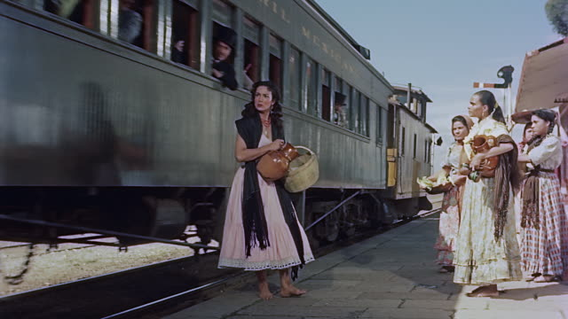 woman gets into a train and serves drinks and food. she is told to get out of the train. - locomotive stock-videos und b-roll-filmmaterial