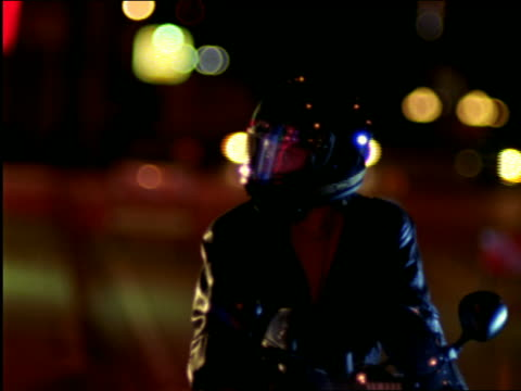 woman gets on back of motorcycle - biker jacket stock videos and b-roll footage