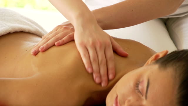 woman getting a back massage - massage stock videos & royalty-free footage