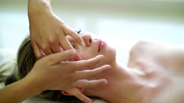 woman getting a body massage - shirodhara stock videos & royalty-free footage