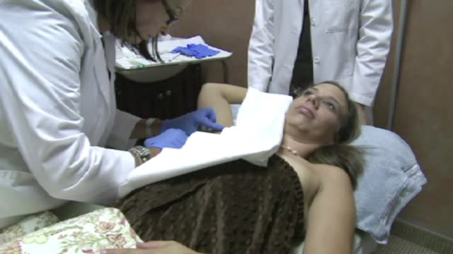 kdaf woman getting botox injections in her armpit on february 12 2012 in dallas texas - armpit stock videos and b-roll footage