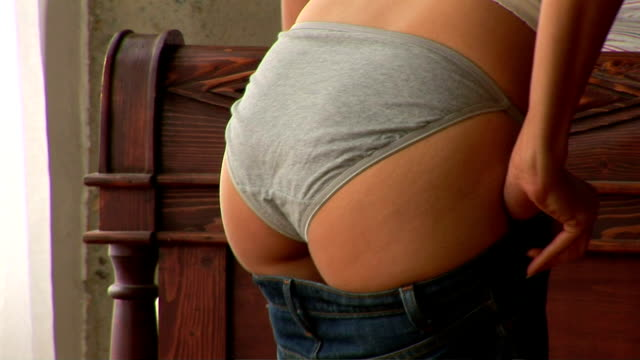 woman getting dressed - pants stock videos and b-roll footage