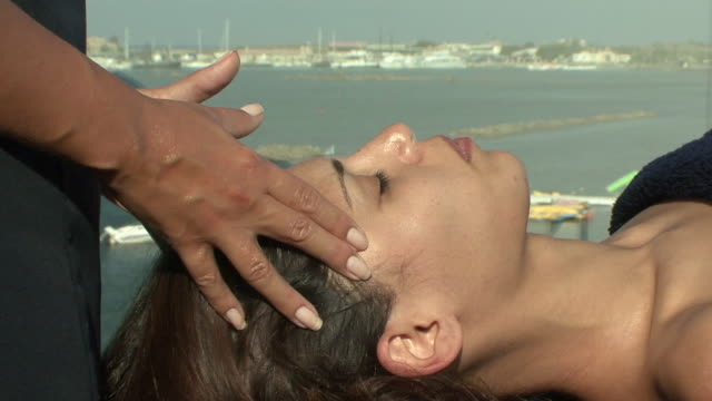 ms woman getting face massage / paphos, cyprus - facial massage stock videos and b-roll footage