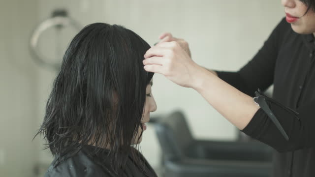 woman getting haircut at beauty salon. japan - bangs stock videos and b-roll footage
