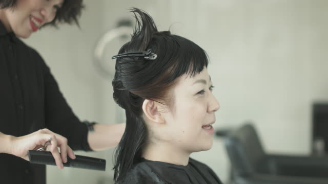 woman getting haircut at beauty salon. japan - hairdresser stock videos & royalty-free footage