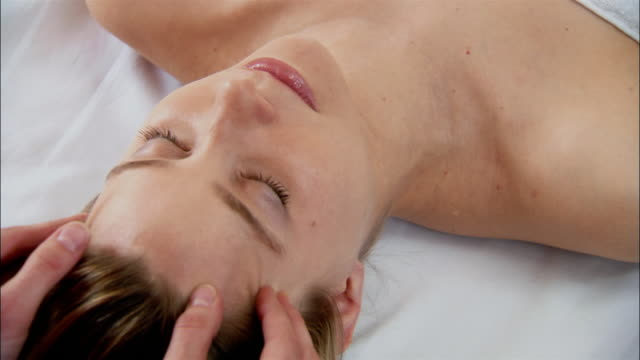 woman getting head massage at spa - massaging stock videos & royalty-free footage