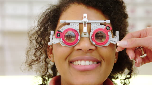 woman getting her eyes tested at optician - lens optical instrument stock videos & royalty-free footage
