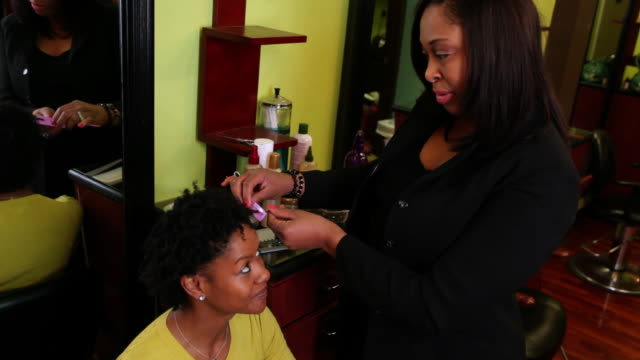 ms woman getting her hair style from beautician at salon / irvington, new jersey, united states - beautician stock videos and b-roll footage