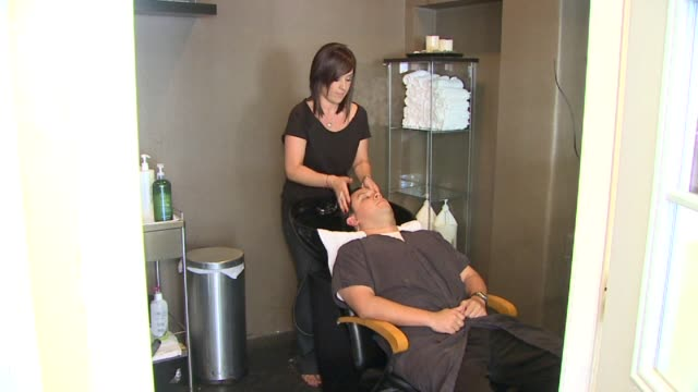 woman getting her hair washed at a salon on september 21 2011 in san diego california - shampoo stock videos & royalty-free footage