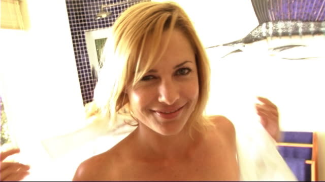 stockvideo's en b-roll-footage met woman getting in bath - one mid adult woman only