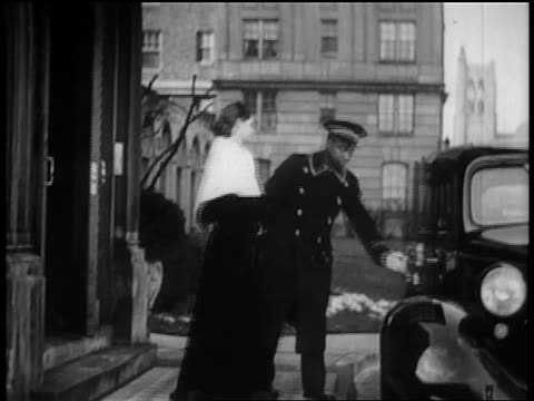 b/w 1935 woman getting into limousine as black doorman holds open door for her / newsreel - 1935 stock videos & royalty-free footage