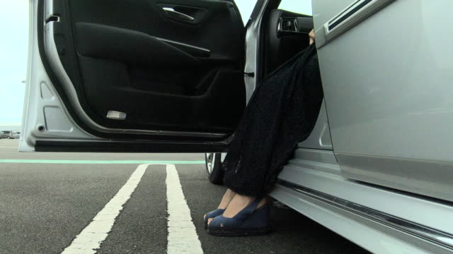 woman getting into the car - car door stock videos & royalty-free footage