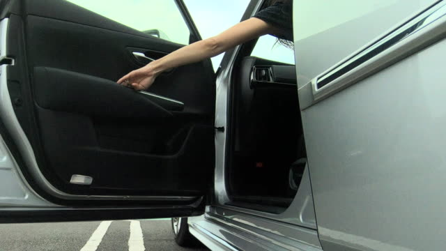 woman getting into the car - entering stock videos & royalty-free footage