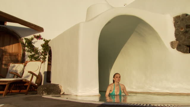 a woman getting out of a luxurious pool - see other clips from this shoot 1144 stock videos & royalty-free footage