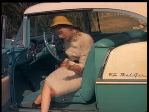 stockvideo's en b-roll-footage met 1955 woman getting out of blue + white chevrolet bel air - 1955