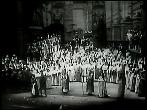 woman getting out of car arriving for opera aida performance ws many opera singers gathered on stage audience of soldiers opera singers gathered... - 1935 stock videos & royalty-free footage